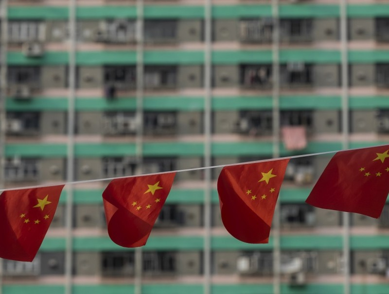 Chinese national flags displayed at Wong Tai Sin Temple to mark National Day in Hong Kong, China, on 1 October 2021. (Paul Yeung/Bloomberg)