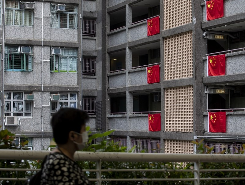 Chinese national flags on display in a public housing block in Wong Tai Sin district to mark National Day in Hong Kong, China, on 1 October 2021. (Paul Yeung/Bloomberg)