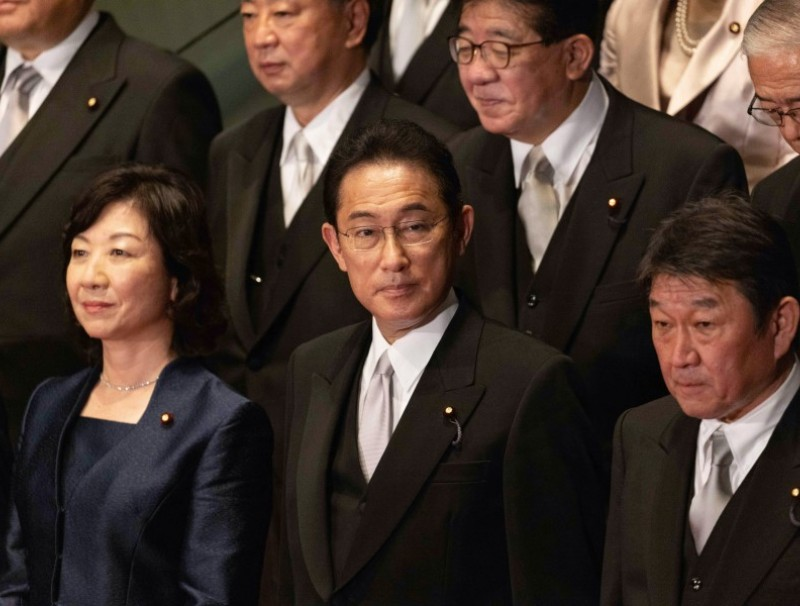 Fumio Kishida, Japan's prime minister, center, during a group photograph with his new cabinet members at prime minister's official residence in Tokyo, Japan, on 4 October 2021. (Stainislav Kogiku/SOPA Images/Bloomberg)