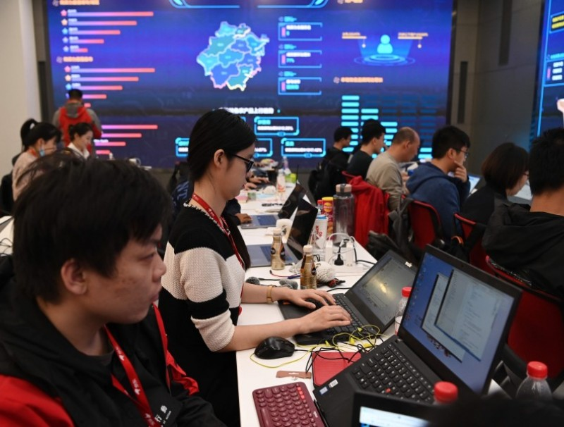 Data room operators work at the headquarters of online shopping platform JD.com during the Singles' Day shopping festival in Beijing on 11 November 2020. (Greg Baker/AFP)
