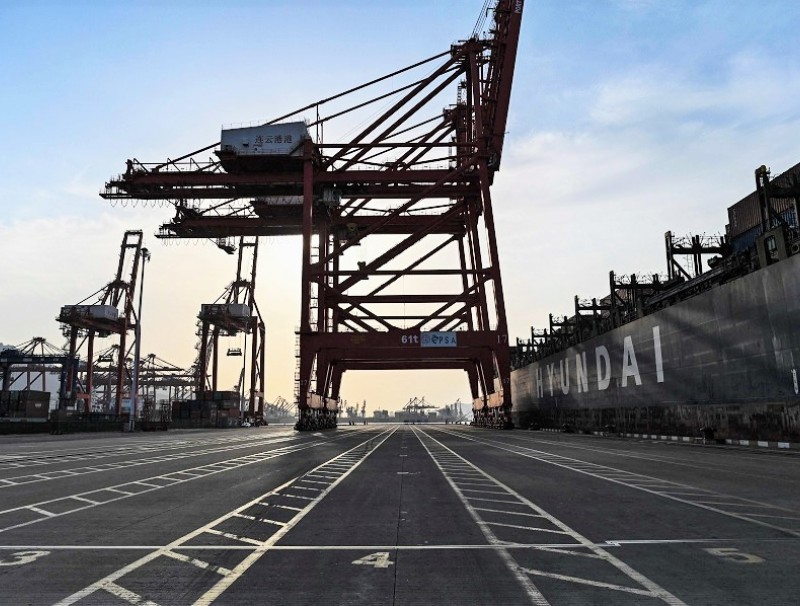 A general view shows a cargo ship and cranes at the port of Lianyungang, Jiangsu province, China, on 24 March 2021. (Hector Retamal/AFP)