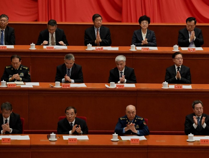 Delegates applaud during the commemoration of the 110th anniversary of the Xinhai Revolution, at the Great Hall of the People in Beijing on 9 October 2021. (Noel Celis/AFP)