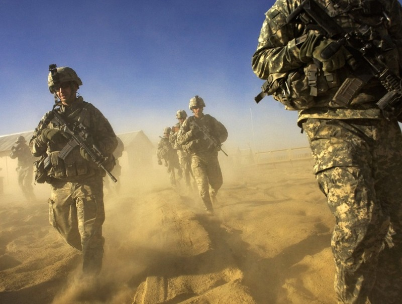 In this file photo taken on 28 November 2008, US Army soliders from 1-506 Infantry Division set out on a patrol in Paktika province, situated along the Afghan-Pakistan border. (David Furst/AFP)
