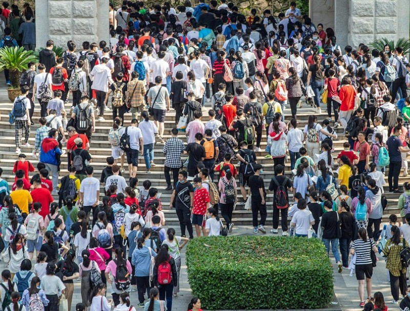 This file photo taken on 7 July 2020 shows students arriving at a school to take the gaokao, in Nanjing, Jiangsu province, China. (STR/AFP)