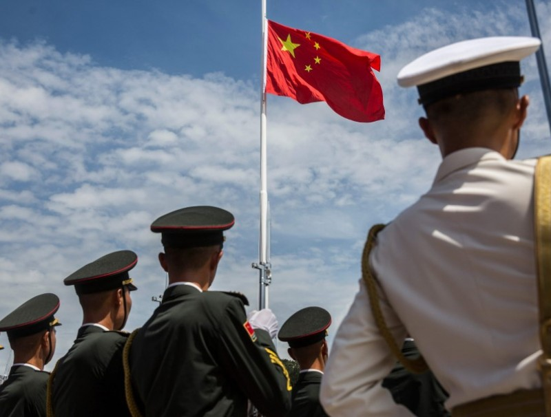 This file photo shows soldiers from the Peoples' Liberation Army (PLA) during a flag raising ceremony, 30 June 2019. (Isaac Lawrence/AFP)