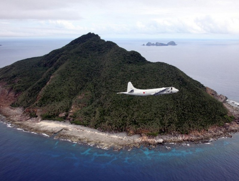 This file photo taken on 13 October 2011 shows a P-3C patrol plane of Japanese Maritime Self-Defense Force flying over the disputed islets known as the Senkaku islands in Japan and Diaoyu islands in China, in the East China Sea. A local assembly of Japan's southern Okinawa island on June 22, 2020 approved a plan to rename the area covering disputed islands in the East China Sea, sparking protests from Beijing and Taipei. (STR/AFP)