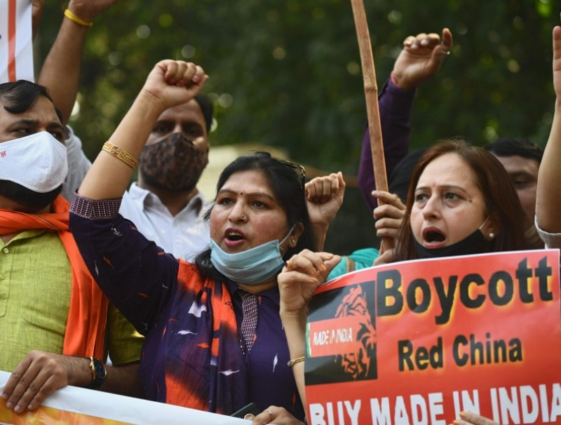 Demonstrators shout slogans as they take part in a protest march against China near the Chinese Embassy in New Delhi on 20 October 2020. (Sajjad Hussain/AFP)