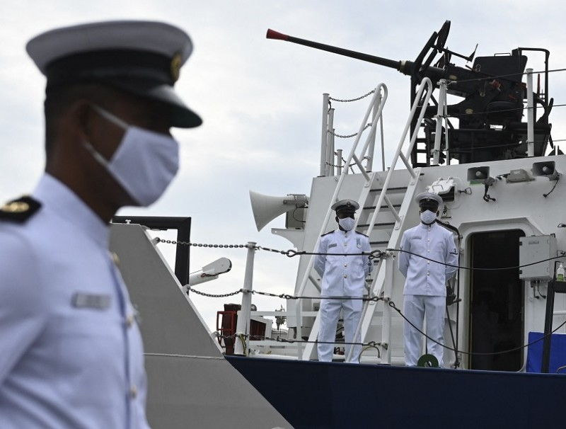 Coast guard officers stand on the deck of the Indian Coast Guard offshore patrol vessel 'VIGRAHA' during its commissioning ceremony, in Chennai, India, on 28 August 2021. (Indian Navy/AFP)