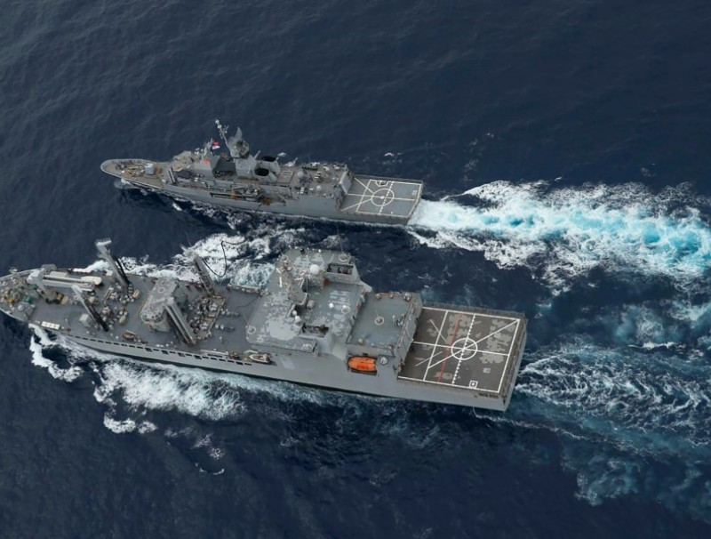 This handout photo taken and released by the Indian Navy on 18 November 2020 shows a ship refuelling during the second phase of the Malabar naval exercise in the Arabian sea. (Indian Navy/AFP)
