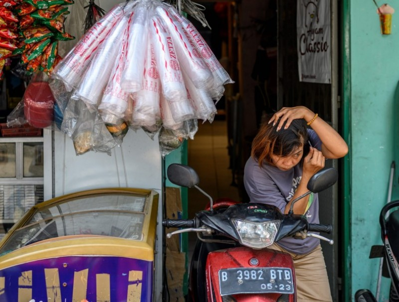 A Chinese ethnic woman at her shop in Chinatown in Jakarta, 7 May 2020. (Bay Ismoyo/AFP)