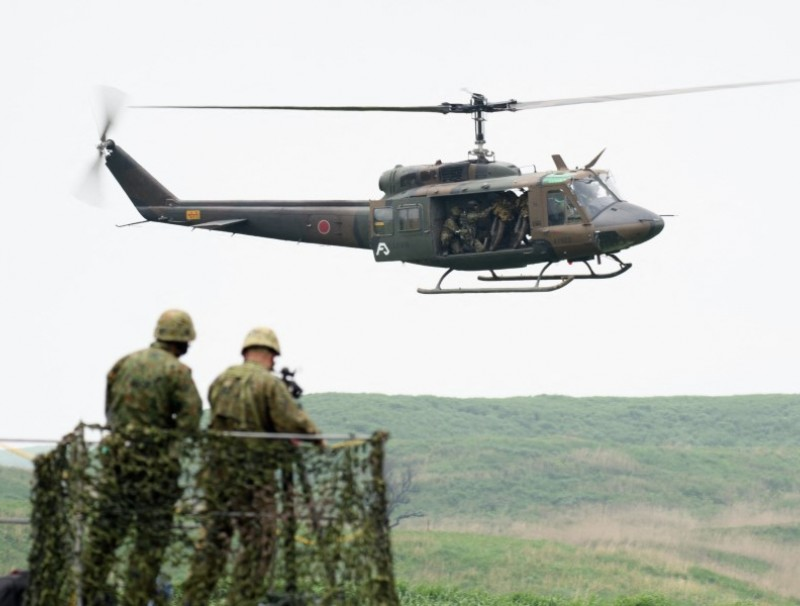 A UH-1J helicopter flies during a live fire exercise at Japan's Ground Self-Defense Forces (JGSDF) training grounds in the East Fuji Manuever Area in Gotemba on 22 May 2021. (Akio Kon/AFP)