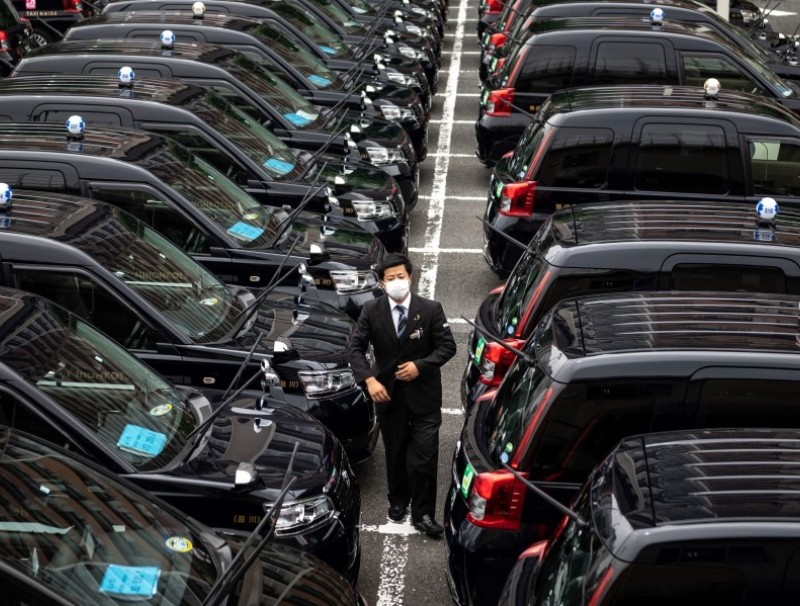 This picture taken on 7 July 2021 shows vehicles in Tokyo. (Philip Fong/AFP)