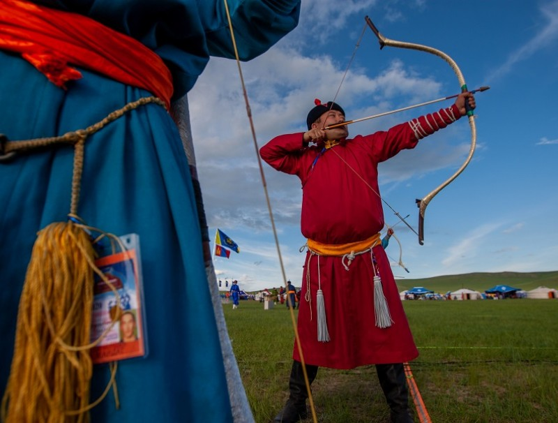This photo taken on 11 July 2020 shows competitors during an archery competition at the annual Naadam sports festival near Ulaanbaatar, in Mongolia. (Byambasuren Byamba-ochir/AFP)