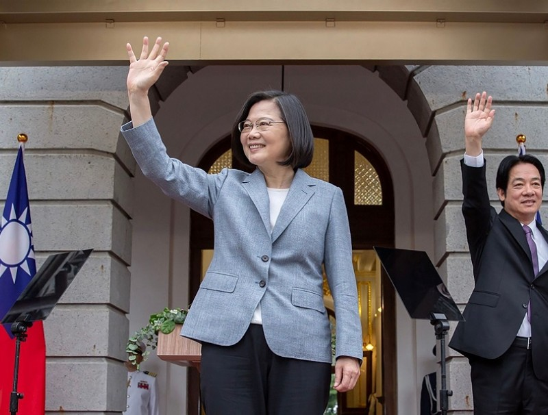 This handout picture taken and released on 20 May 2020 by the Taiwan Presidential office shows Taiwan's President Tsai Ing-wen (centre) and Vice President William Lai waving during an inauguration event for their respective terms in office, at the Taipei Guest House in Taipei. (Handout/Taiwan Presidential Office/AFP)