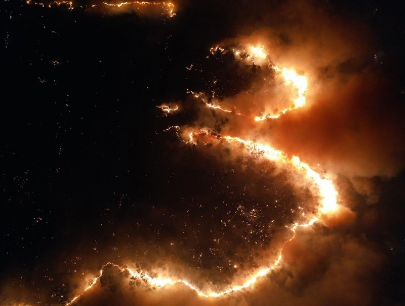 This aerial handout photo taken on March 18, 2020 and released by Thai volunteer group Jit Arsa shows a night time view of fires in Mae Rim district in northern Chiang Mai province, where the blazes have severely impacted air quality. (Handout/Jit Arsa/AFP)