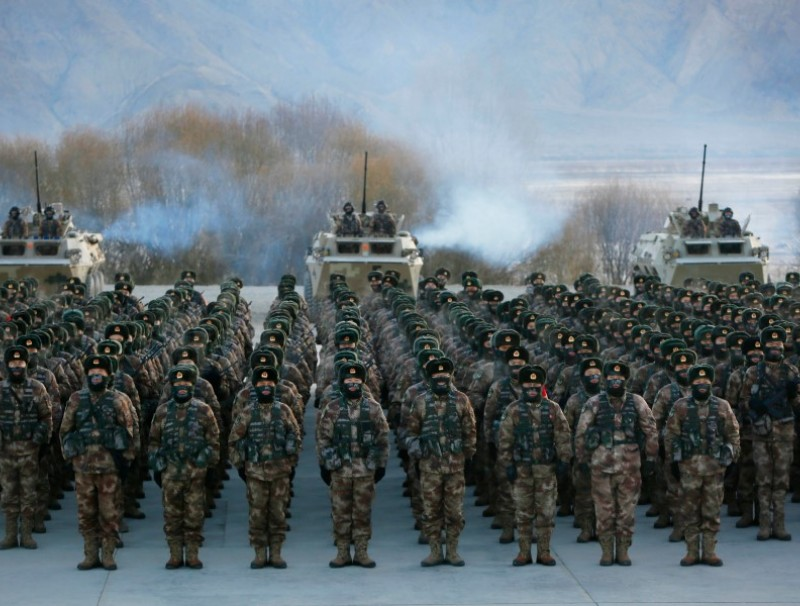 This photo taken on 4 January 2021 shows Chinese People's Liberation Army (PLA) soldiers assembling during military training at Pamir Mountains in Kashgar, northwestern China's Xinjiang region. (STR/AFP)