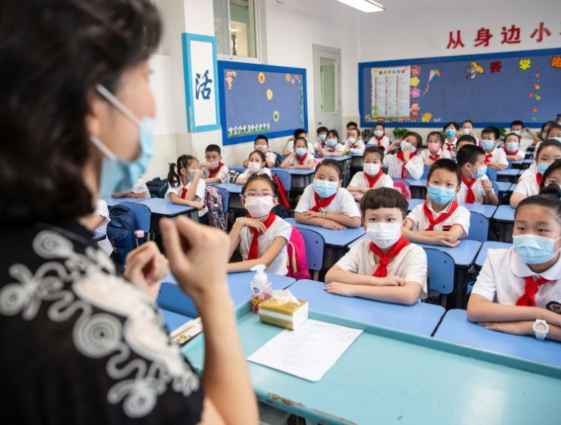 This photo taken on 1 September 2020 shows elementary school students attending a class on the first day of the new semester in Wuhan in China's central Hubei province. (STR/AFP)