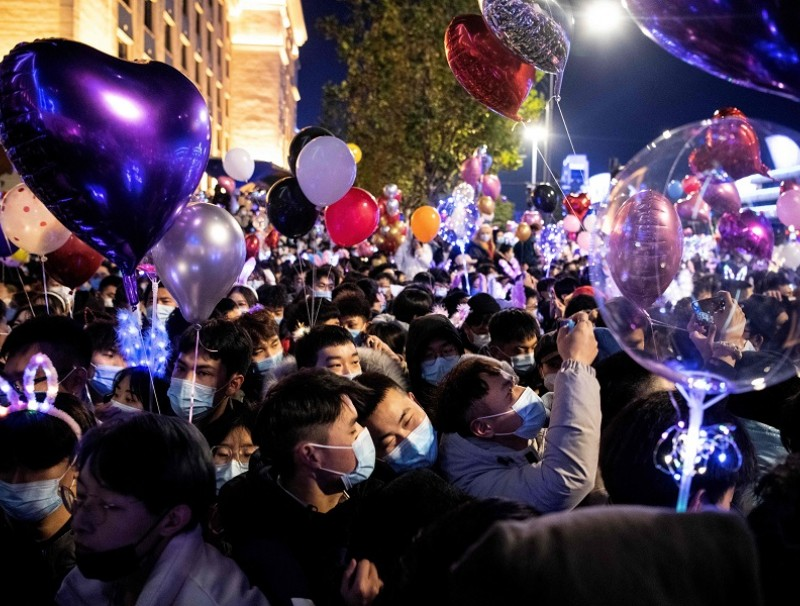 People wearing face masks attend a New Year's countdown in Wuhan, Hubei province, China, on 31 December 2020. (Noel Celis/AFP)