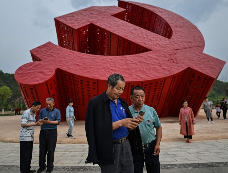 A pit stop on a government organised media tour — a monument of the hammer and sickle in Nanniwan, some 60 km from Yan'an, the headquarters of the Chinese Communist Party from 1936 to 1947, in Shaanxi province, China on 11 May 2021. (Hector Retamal/AFP) (Hector Retamal/AFP)