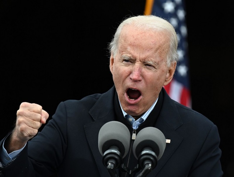 US President-elect Joe Biden gestures as he speaks during a campaign rally to support Democratic Senate candidates in Atlanta, Georgia on 15 December 2020. (Jim Watson/AFP)