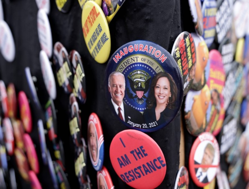 A button featuring President-elect Joe Biden and Vice President-elect Kamala Harris' inauguration is on display by a street vendor in Eatonton, Georgia, 2 January 2021. (Alex Wong/AFP)