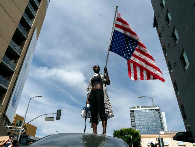 A protester takes a moment while speaking to the crowd as they march through Hollywood during a demonstration over the death of George Floyd while in Minneapolis Police custody, in Los Angeles, California, June 2, 2020. - Anti-racism protests have put several US cities under curfew to suppress rioting, following the death of George Floyd in police custody. (Kyle Grillot/AFP)