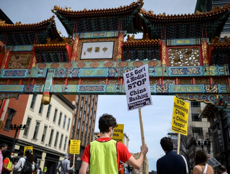 People participate in an 'Anti-Asian Hate' rally in Chinatown in Washington, DC, US, on 27 March 2021. (Andrew Caballero-Reynolds/AFP)