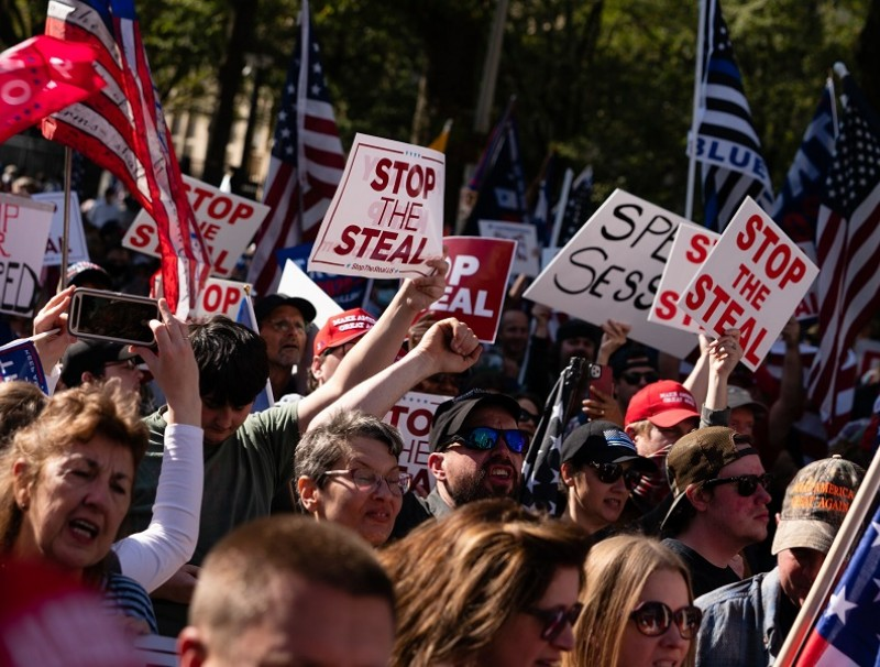 Protesters rally outside the Georgia State Capitol against the results of the 2020 Presidential election on 21 November 2020 in Atlanta, Georgia. (Elijah Nouvelage/Getty Images/AFP)