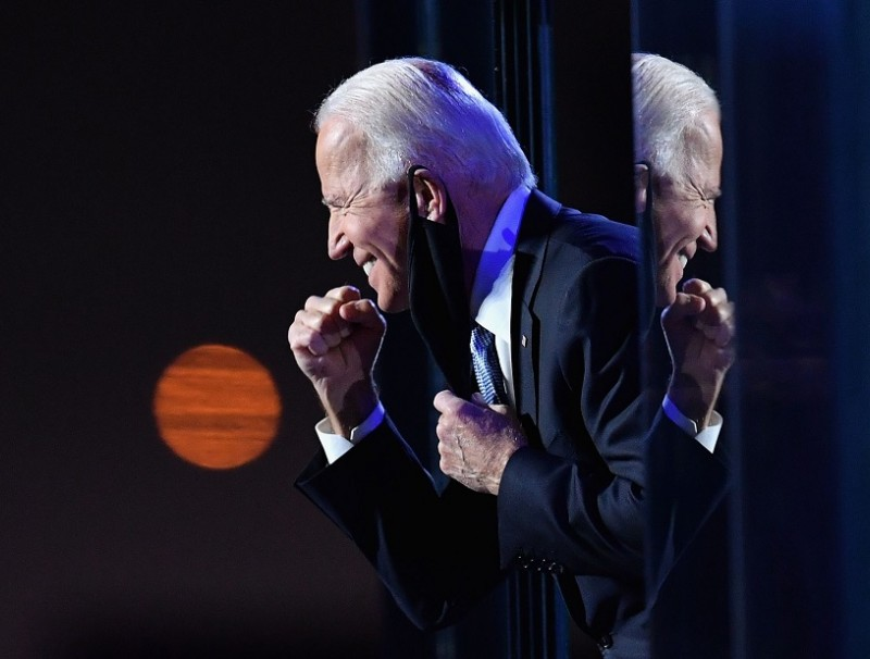 US President-elect Joe Biden gestures to the crowd after he delivered remarks in Wilmington, Delaware, on 7 November 2020. (Angela Weiss/AFP)