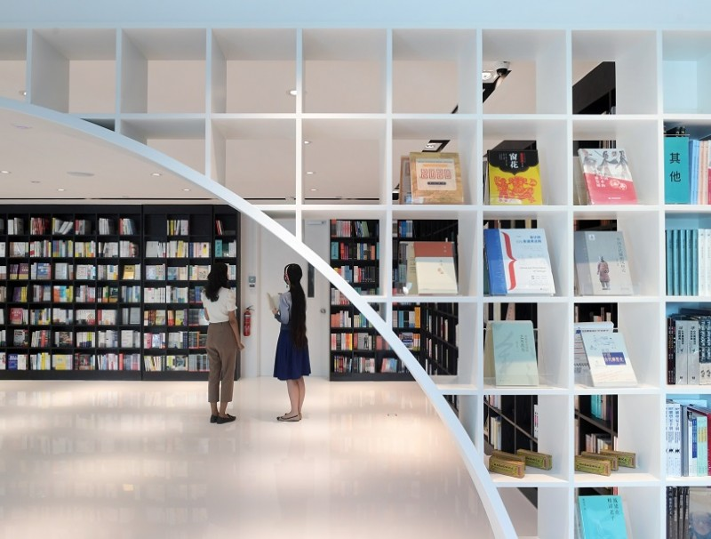 Zall Bookstore's black-and-white design is inspired by calligraphy and the architecture of Jiangnan Watertown, with a circular arch resembling a river bridge. (SPH)