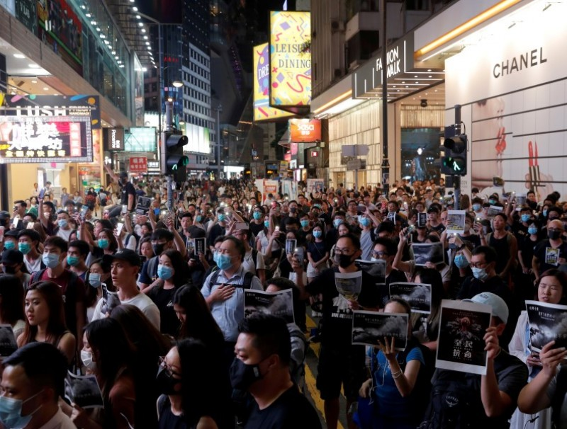 A march in Causeway Bay, in solidarity with the student protester who got shot by police with live ammunition in Hong Kong, China. (Susana Vera/Reuters)