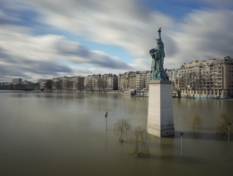 The Statue of Liberty in Paris, during a winter flood. Humans have always struggled to master nature. (iStock)