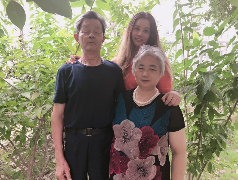 Tang Jinglin, his wife, and his daughter, now city-dwellers. (Photo: Tang Jinglin)