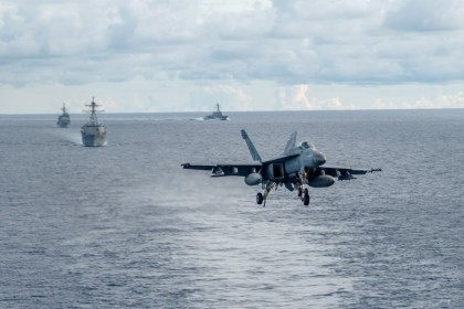 An F/A-18E Super Hornet, attached to the Dambusters of Strike Fighter Squadron (VFA) 195, approaches the flight deck of the Navy's forward-deployed aircraft carrier USS Ronald Reagan (CVN 76) during a drill in the South China Sea, 6 July 2020. (MC2 Samantha Jetzer/Handout/US Navy)