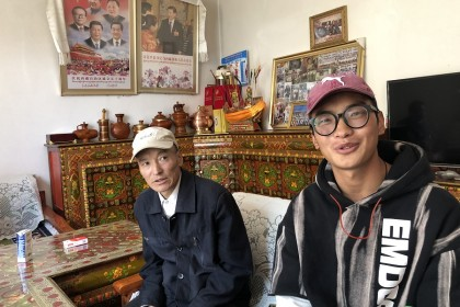 Young Tibetan Danzeng Duoji (right) has no plans to go back to the farm.