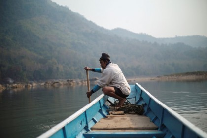 A local villager drive a boat where the future site of the Luang Prabang dam will be on the Mekong River, outskirt of Luang Prabang province, Laos, February 5, 2020. (Panu Wongcha-um/REUTERS)