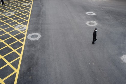 A man wearing a face mask crosses a road in Wuhan. China has not handled the Covid-19 epidemic well, and its shortcomings are showing. (Reuters)