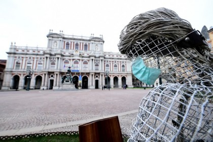 A face mask is attached to the sculpture at the Carlo Alberto Square, in Turin, Italy. (Massimo Pinca/REUTERS)