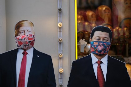 Cardboard cutouts of US President Donald Trump and Chinese President Xi Jinping with protective masks, near a gift shop in Moscow, March 23, 2020. (Evgenia Novozhenina/REUTERS)