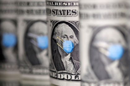 George Washington is seen with printed medical mask on the one Dollar banknotes in this illustration, 31 March 2020. (Dado Ruvic/REUTERS)