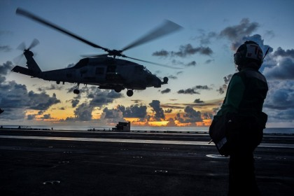 An MH-60R Sea Hawk helicopter launches during flight operations aboard the US Navy aircraft carrier USS Ronald Reagan in the South China Sea, 17 July 2020. (US Navy/Handout via REUTERS)