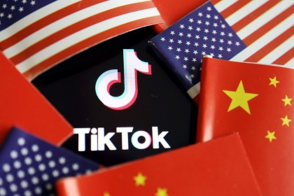 China and US flags are seen near a TikTok logo in this illustration picture taken on 16 July 2020. (Florence Lo/Illustration/File Photo/Reuters)