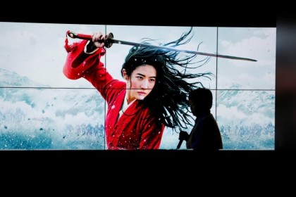 A cleaner walks past screens promoting Disney's movie Mulan as the film opens in China, at a cinema in Beijing, China, 11 September 2020. (Florence Lo/Reuters)