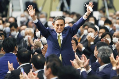 Yoshihide Suga gestures as he is elected as new head of the ruling party at the Liberal Democratic Party's (LDP) leadership election paving the way for him to replace Shinzō Abe, in Tokyo, 14 September 2020. (Kyodo via REUTERS)