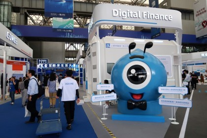 A booth of digital finance products is seen at a fair during the INCLUSION fintech conference in Shanghai, China, 24 September 2020. (Cheng Leng/Reuters)