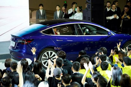 A Tesla China-made Model 3 vehicle owner sits inside a car during a delivery event at Tesla's Shanghai factory in China, 7 January 2020. (Aly Song/File Photo/Reuters)