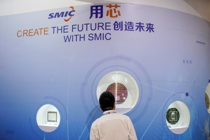 A man visits a Semiconductor Manufacturing International Corporation (SMIC) booth, at China International Semiconductor Expo, in Shanghai, China, 14 October 2020. (Aly Song/Reuters)