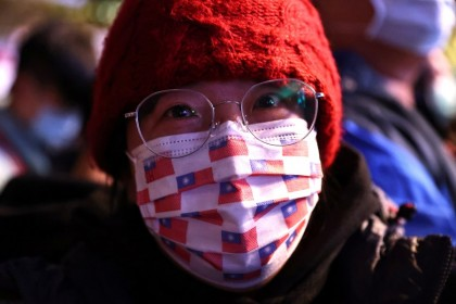 A woman wears a face mask with a Taiwan flag print during a New Year celebration in Taipei, Taiwan, 1 January 2021. (Ann Wang/REUTERS)