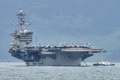 The USS Theodore Roosevelt (CVN-71) is pictured as it enters the port in Da Nang, Vietnam, 5 March 2020. (Kham/Reuters)