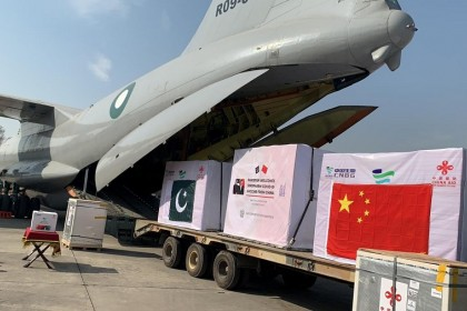 A general view of the first consignment of the Covid-19 vaccines from China, seen offloading from a plane at the PAF Base Nur Khan, Pakistan in this handout photo released by Inter-Services Public Relations (ISPR) on 1 February 2021. (Inter-Services Public Relations (ISPR)/Handout via Reuters)